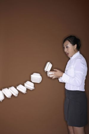 mouth opened: Young woman watching with mouth opened as the take out food falling off her hands Stock Photo