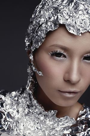 Woman wearing foil accessories
