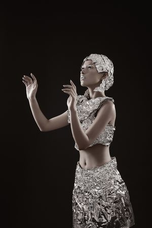 Woman wearing foil accessories with hand gestures