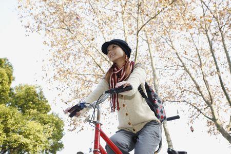Woman riding tandem bicycle Stock Photo - 10295495