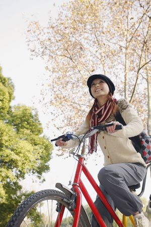 Woman riding tandem bicycle Stock Photo - 10296463