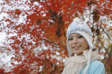 Woman wearing knit hat smiling