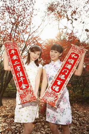 Women in cheongsam holding banners photo