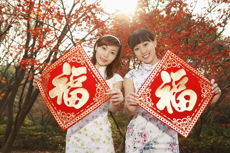 Women holding chinese new year decorative item photo