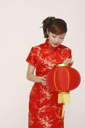 cheongsam: Woman in red cheongsam holding lantern Stock Photo