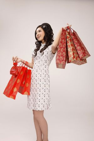 Woman in cheongsam carrying paperbags photo