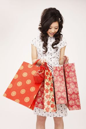 cheongsam: Woman looking into paperbags