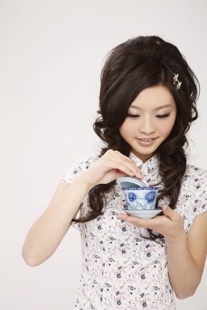 Woman enjoying a cup of chinese tea