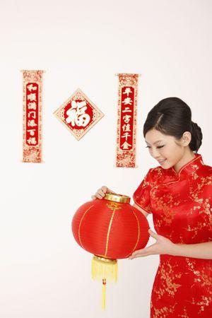 cheongsam: Woman in cheongsam holding lantern