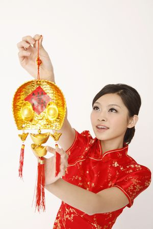 Woman hanging chinese new year decorative item