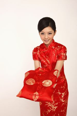 cheongsam: Woman holding chinese man traditional clothing