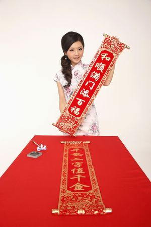 Woman holding banner with New Years greeting