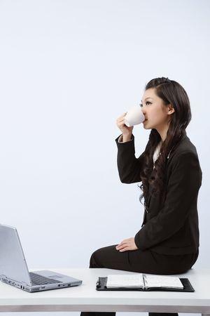 Woman enjoying a cup of coffee photo