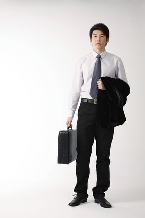 Man holding suit and bag