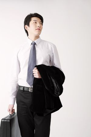 Man holding suit and bag Stock Photo - 4778732