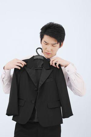Man holding suit on coathanger Stock Photo - 4778874