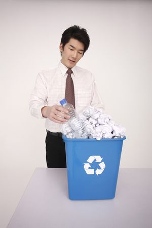 Man throwing plastic bottle into recycle bin Stock Photo - 4778654