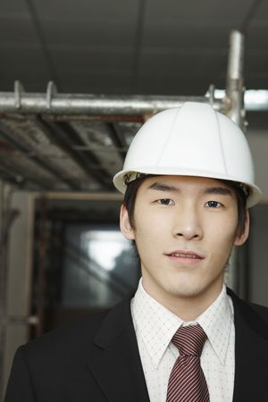 asian architect: Man in full suit wearing safety helmet