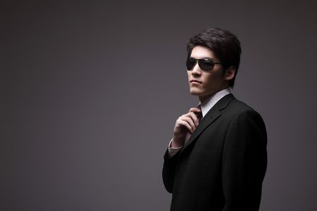Man in full suit with sunglasses Stock Photo