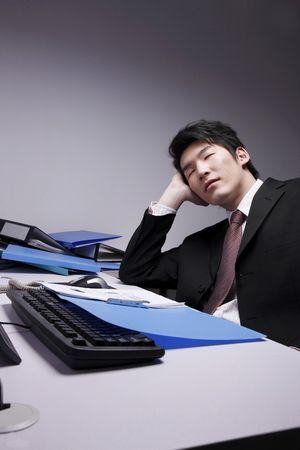Man sleeping with head resting on his palm Stock Photo - 10294476