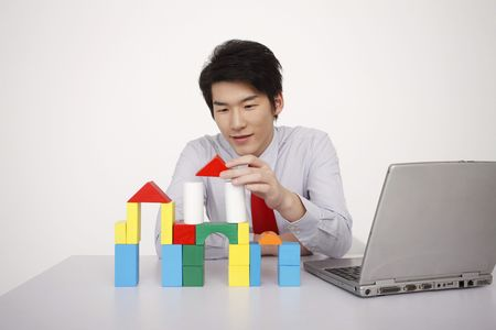 Man stacking wooden blocks