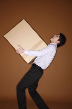 man carrying box: Man carrying a big box Stock Photo