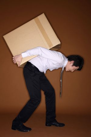 Man carrying a big box on his back photo