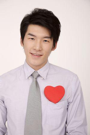 love box: Man with a heart shaped box on his pocket Stock Photo