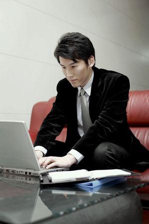 Man using laptop, smiling