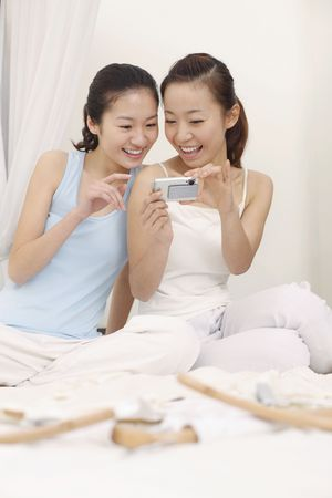 only women: Young women viewing their pictures on the camera