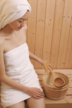 Young woman in sauna photo