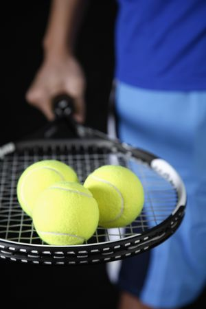 athletic gear: Man holding tennis racquet and tennis ball Stock Photo