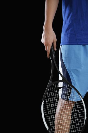 Man holding tennis racquet Stock Photo