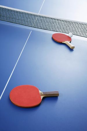 indoor sport: Table tennis bats on table tennis table