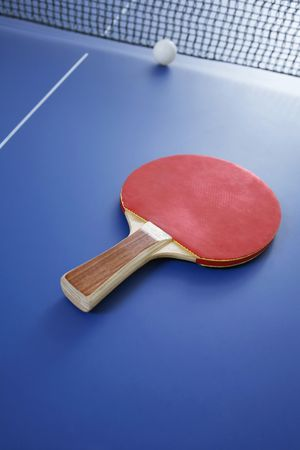 Table tennis bat and ball on table tennis table
