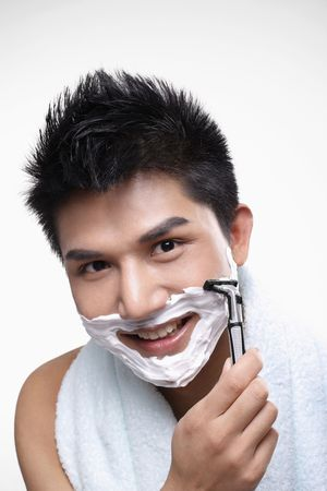 Man shaving with a razor Stock Photo