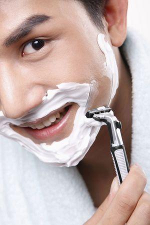 Man shaving with a razor Stock Photo