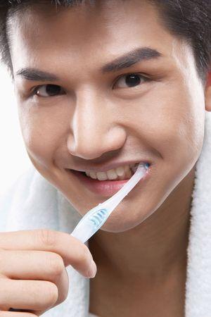Man brushing teeth photo