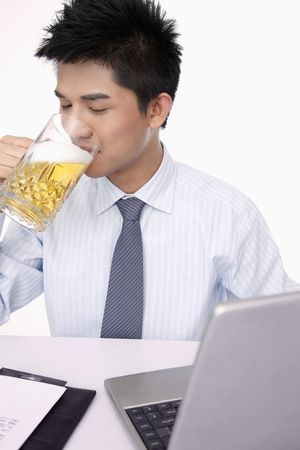 beer and necktie: Businessman enjoying a glass of beer Stock Photo