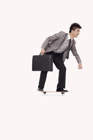 Businessman on skateboard