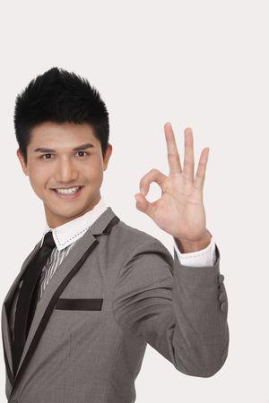 Businessman showing okay hand gesture photo