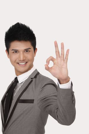 Businessman showing okay hand gesture photo
