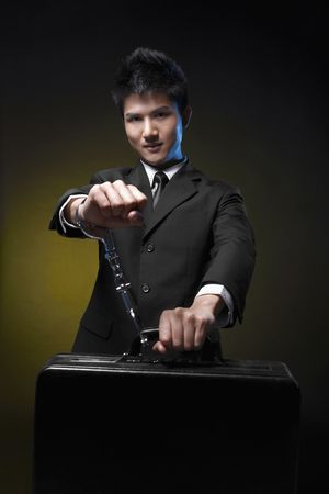 Businessman handcuffed to briefcase Stock Photo - 4810764