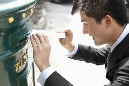Businessman mailing letter photo