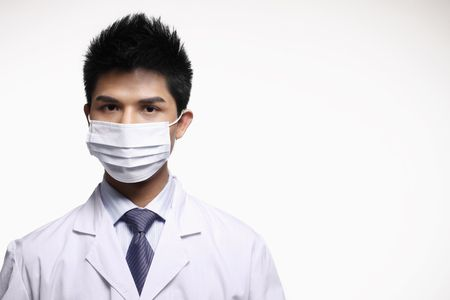 Businessman in lab coat and surgical mask photo
