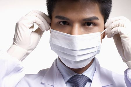 Businessman in lab coat wearing surgical mask photo