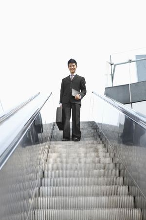 Businessman on escalator Stock Photo - 4810714