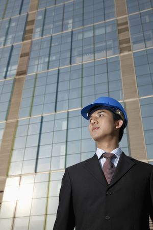 asian architect: Businessman with safety helmet Stock Photo