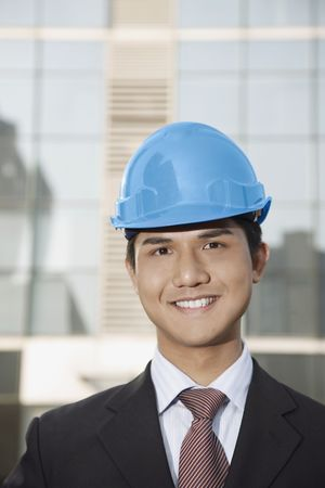 Businessman with safety helmet smiling photo