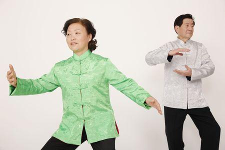 Senior man and woman doing Tai Chi
